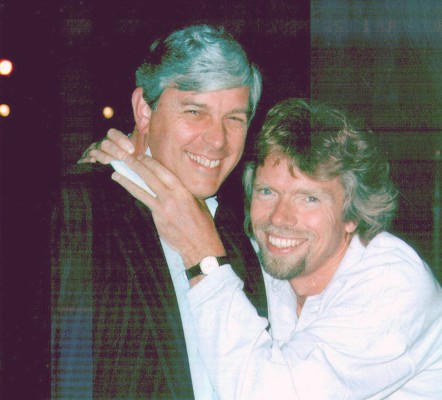 Frequent flier Fred Finn and Richard Branson, founder of Virgin Group, after Finn hit 10 million miles.