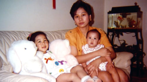 Priscilla Chan as a child with her mom and younger sister.