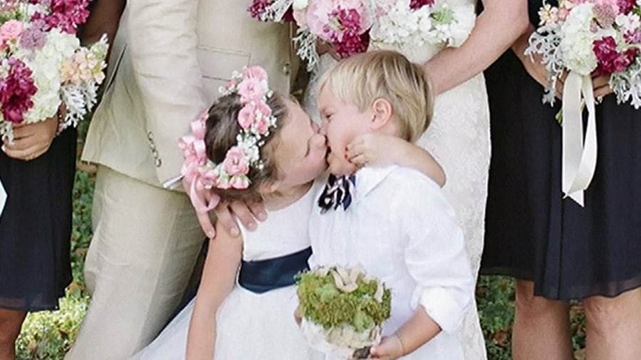 flower girl steals a kiss and the spotlight in viral photo - Wedding Ring Bearer