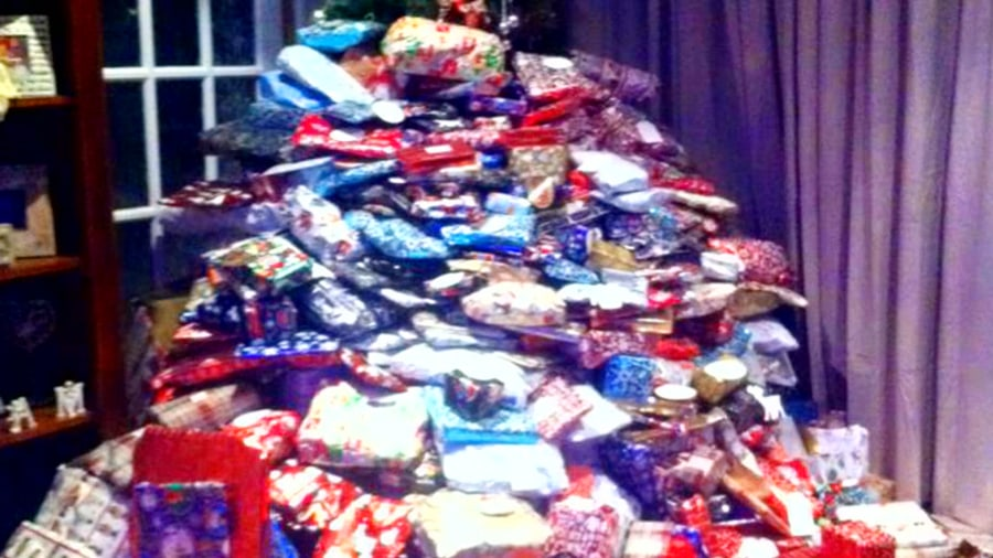 Criticism of christmas tree photo showing pile of presents today com