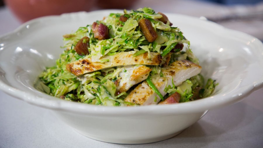 Learn how to make a delicious chicken Caesar salad with Brussels sprouts
