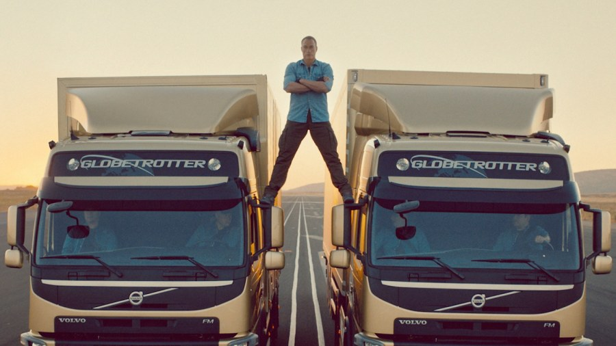 Jean-Claude Van Damme performs amazing split between moving trucks