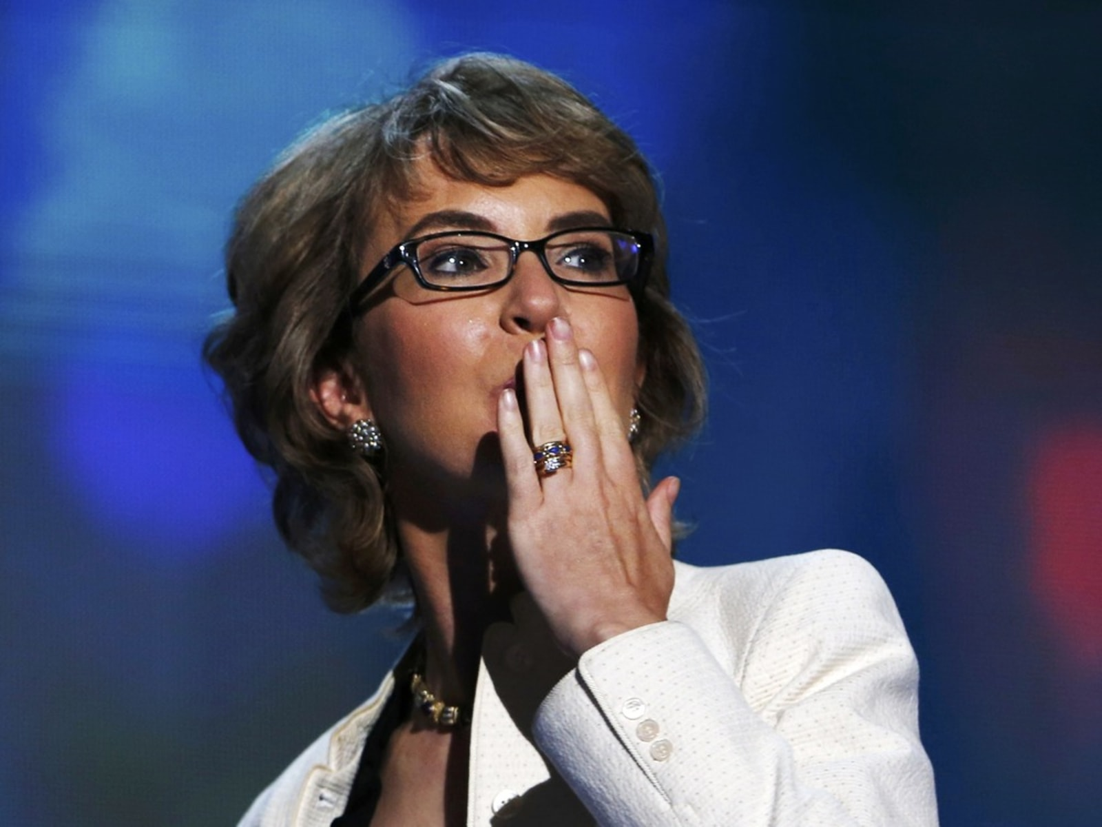 Image: Gabrielle Giffords blows a kiss after reciting the Pledge of Allegiance during the final session of the Democratic National Convention in Charlotte