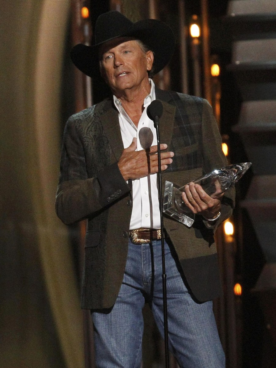 Image: George Strait accepts the award for entertainer of the year at the 47th Country Music Association Awards in Nashville, Tennessee