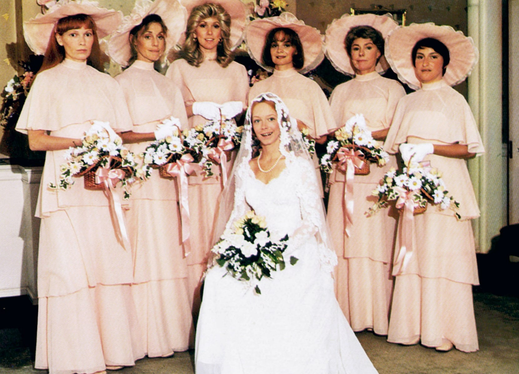smart tips to survive wedding season com image a wedding amy stryker seated standing mia farrow