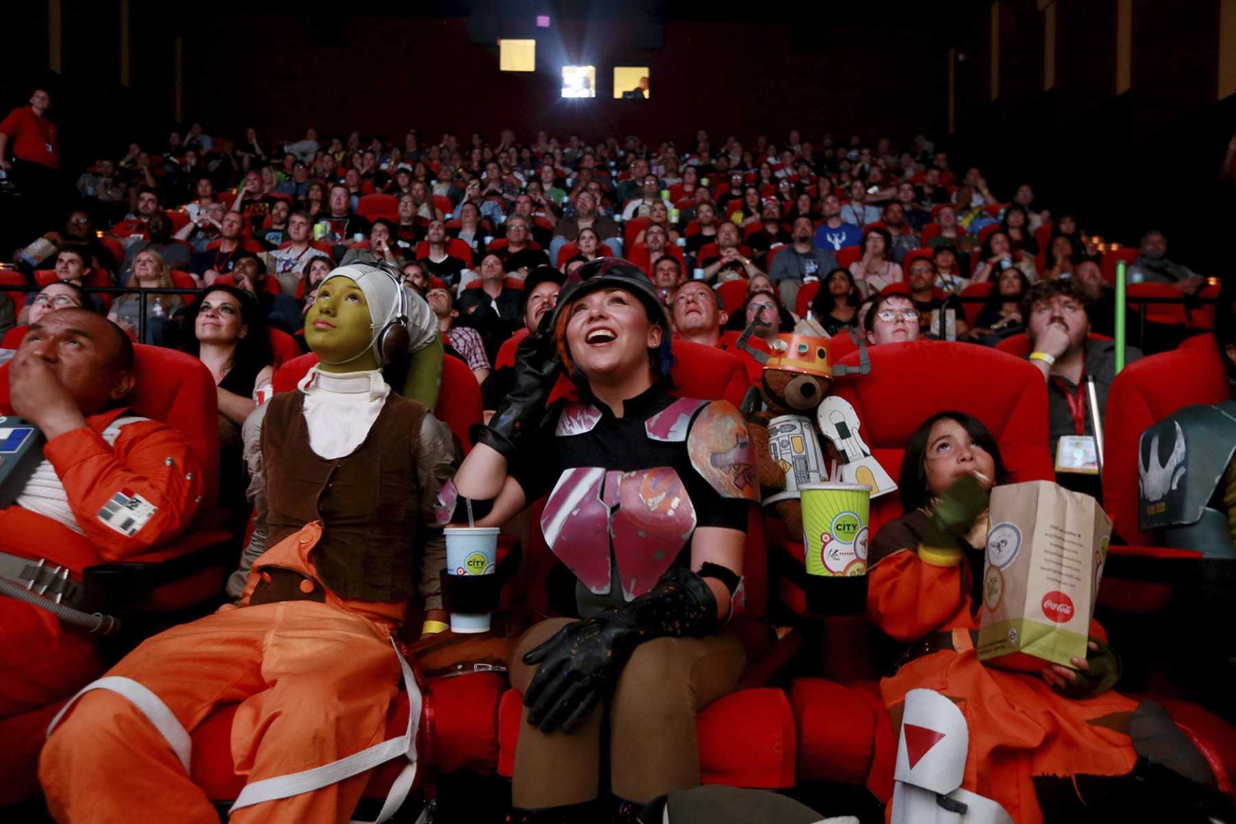 Image: Costumed attendees cheer as they meet the cast of Star Wars Legends during an advanced screening during the 2014 Comic-Con International Convention in San Diego, California