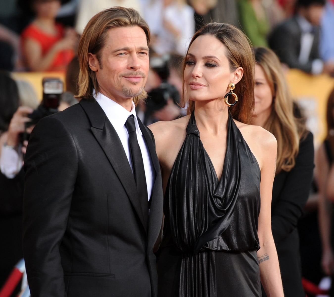 Brad and Jolie, both in black dress in one of the Award function