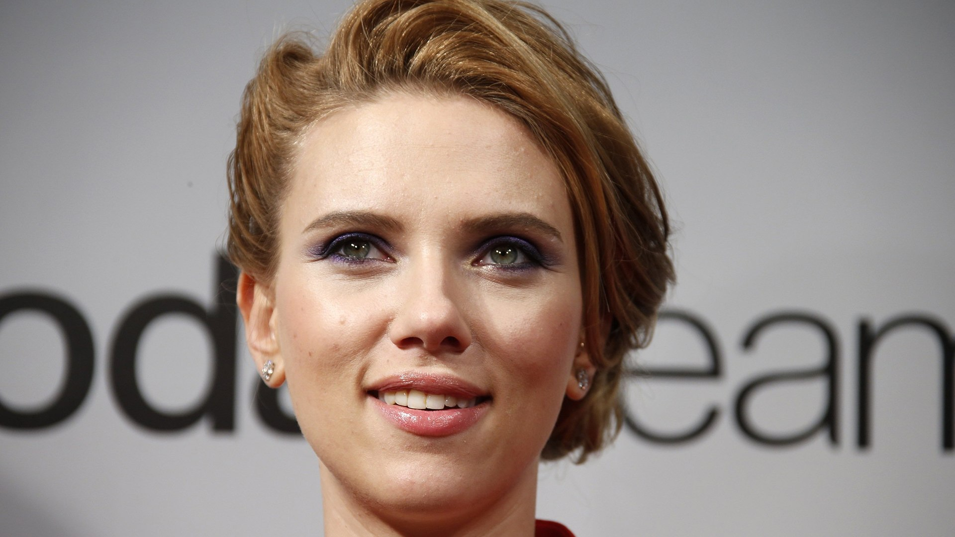 "Image: Cast member Johansson poses at the French premiere of the film ""Captain America: The Winter Soldier"" in Paris"