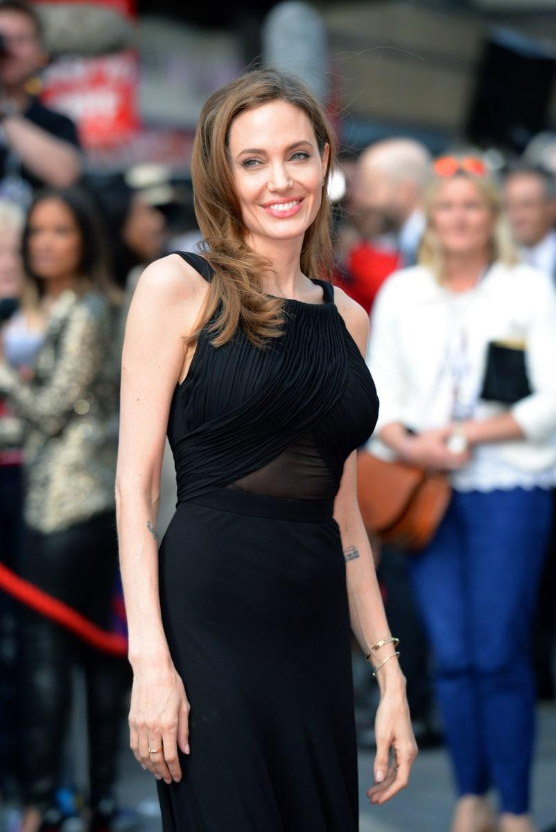 Angelina Jolies Unbroken Hero Was Her Neighbor All Along Jolie Clothing Jamie Long Dress Image Britain Entertainment Film World War Z