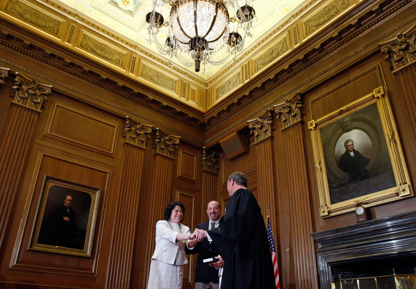 Image: Newly sworn-in U.S. Supreme Court Justice Sotomayor is congratulated by Chief Justice Roberts in Washington
