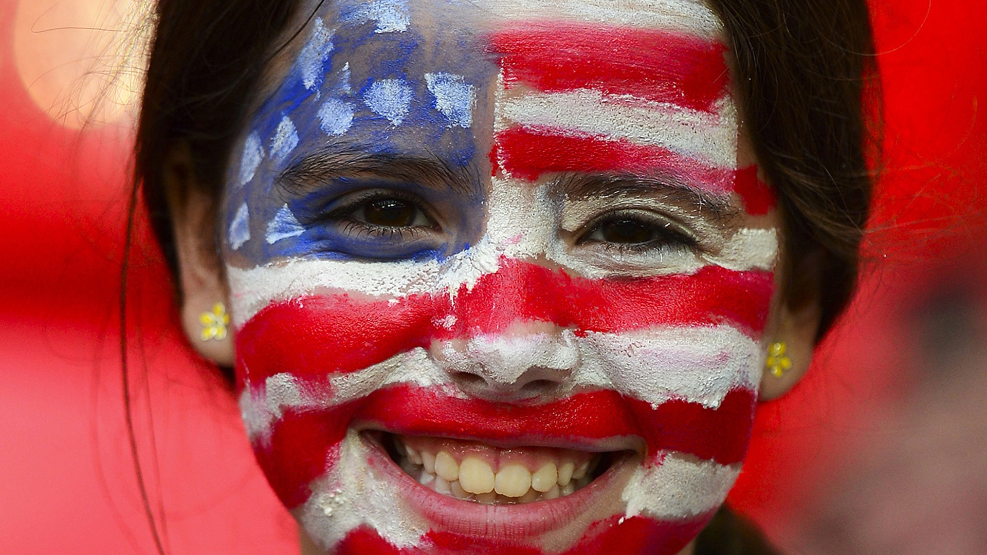 A US supporter has her face painted with