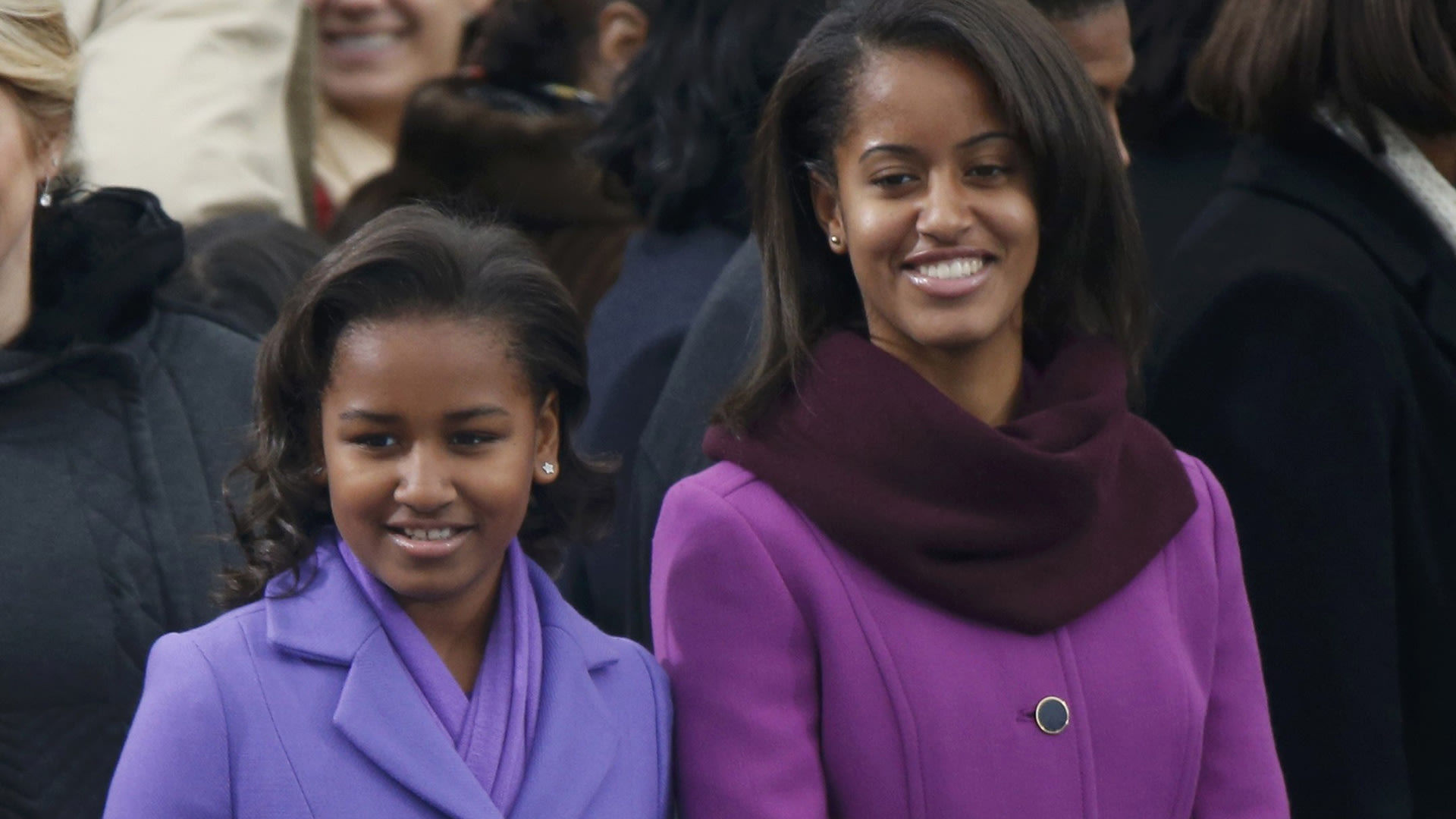 Image: The daughters of President Barack Obama, Sasha and Malia, arrive for the swearing-in ceremonies for their father on the West Front of the U.S. Capitol in Washington