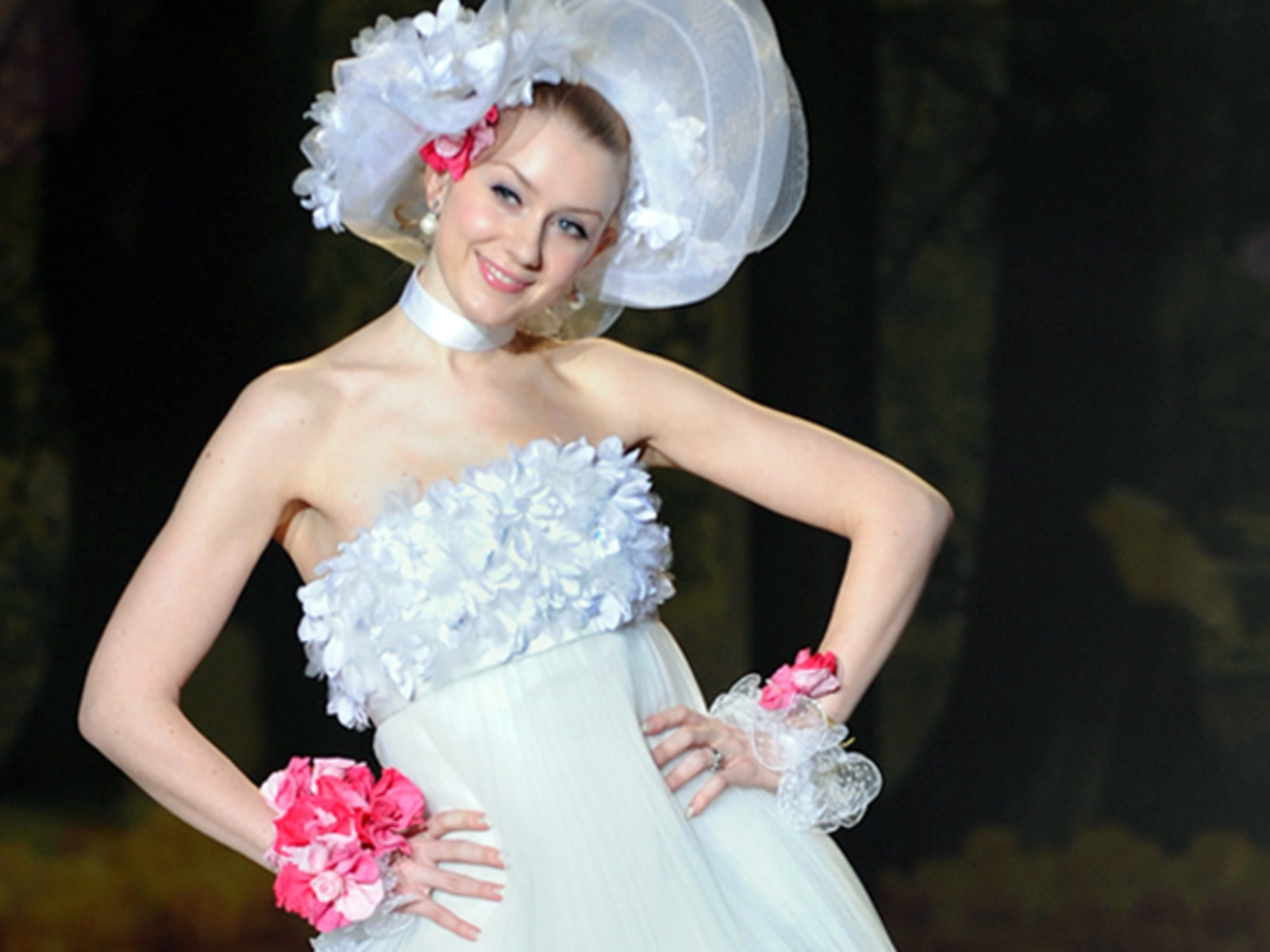 A model shows off a wedding dress by Jap