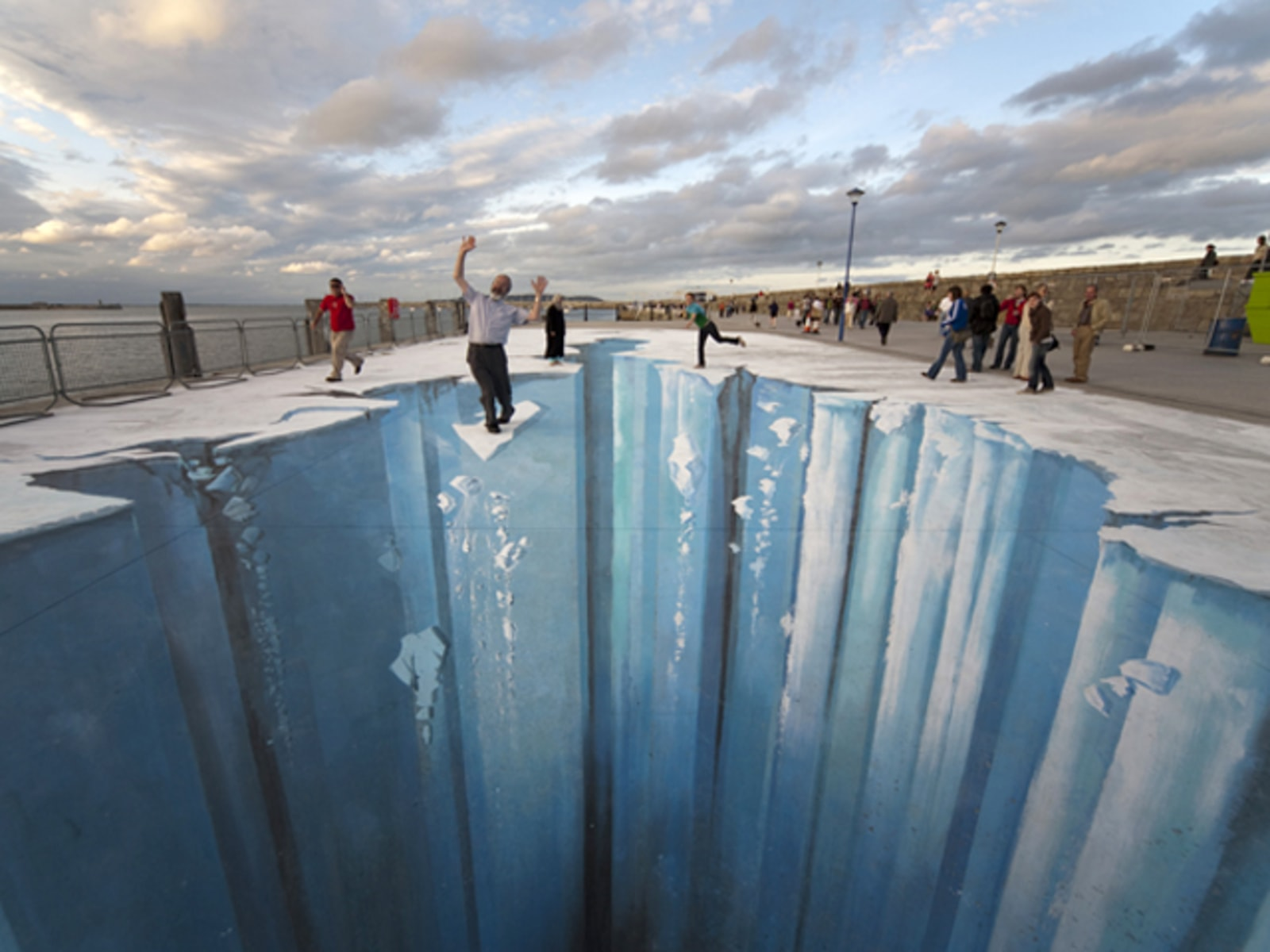 Image: All German artist Edgar Mueller needs to create a 3-D image is a slab of cement and some chalk