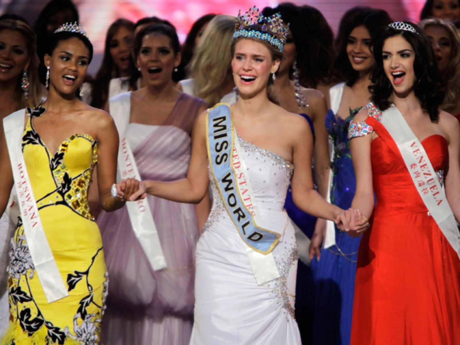 Image: Miss USA and Miss World 2010 Alexandria Mills, first runner-up Miss Botswana Emma Wareus and runner-up Miss Venezuela Adriana Vasini celebrate at the end of the 60th Miss World pageant in Sanya