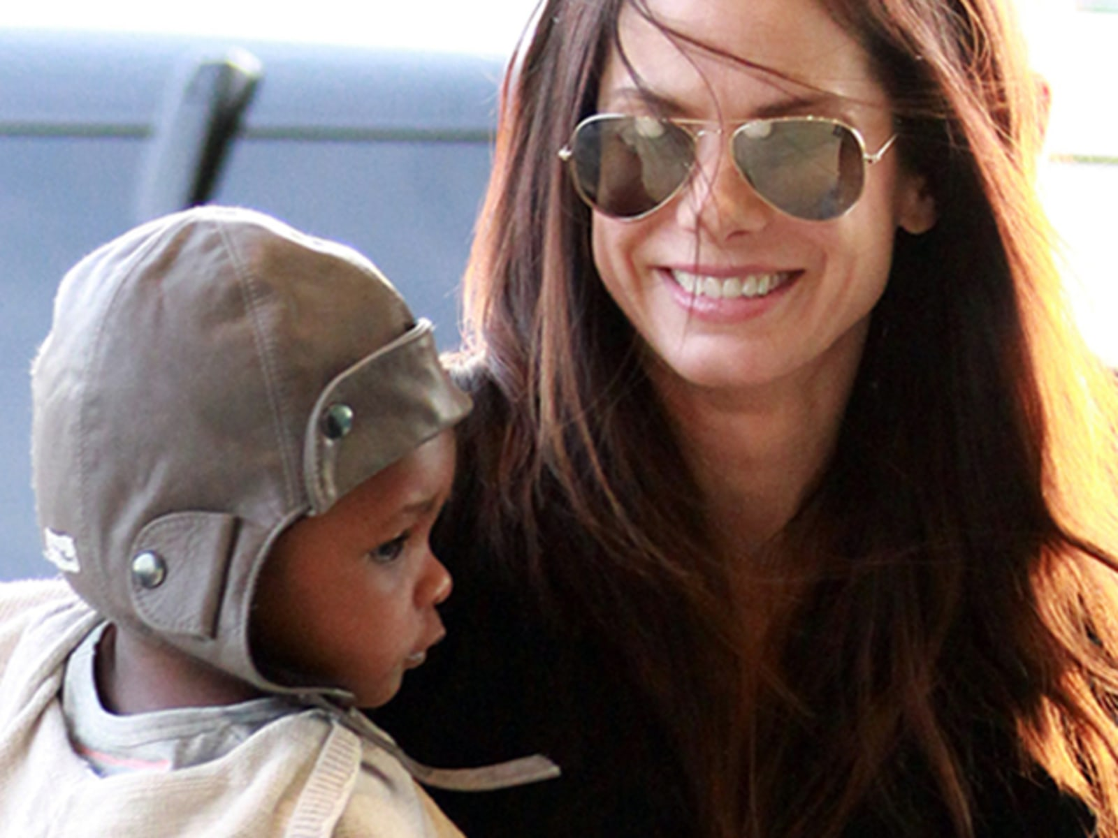 Sandra Bullock And Baby Louis At JFK Airport In New York