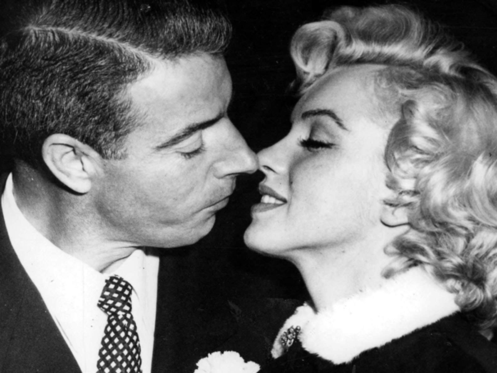 Image: T,V, and Films, 16th January 1954, San Francisco, USA, Legendary Hollywood Film actress Marilyn Monroe prepares to kiss her husband former US Baseball player Joe DiMaggio after their wedding