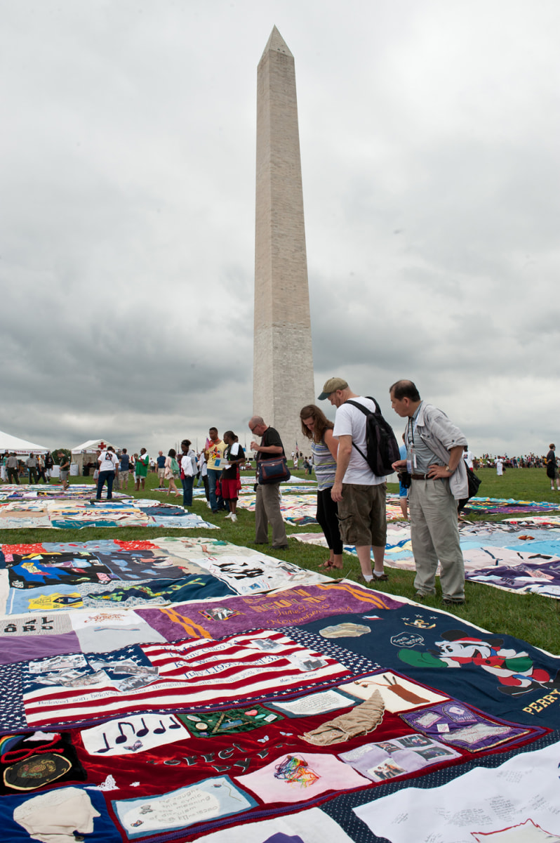 Image: People look at quilts in memory of AIDS