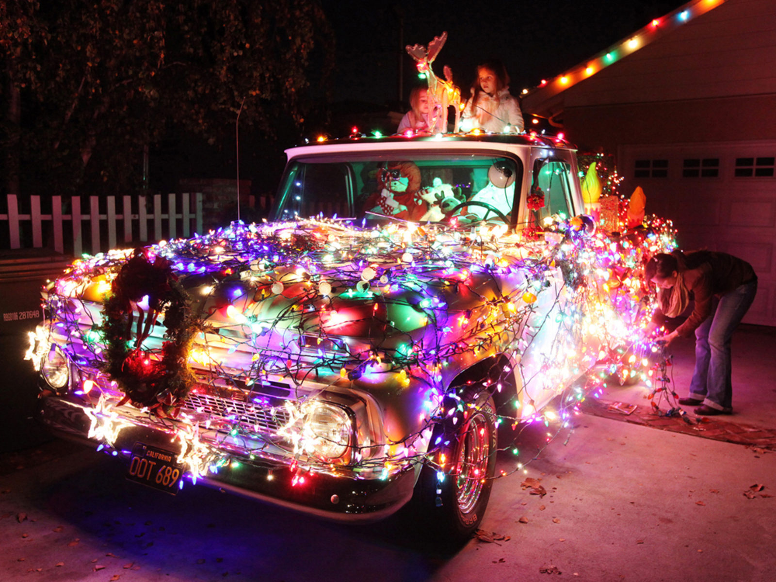 Image: A 1965 Chevy pick-up truck decorated for Christmas.