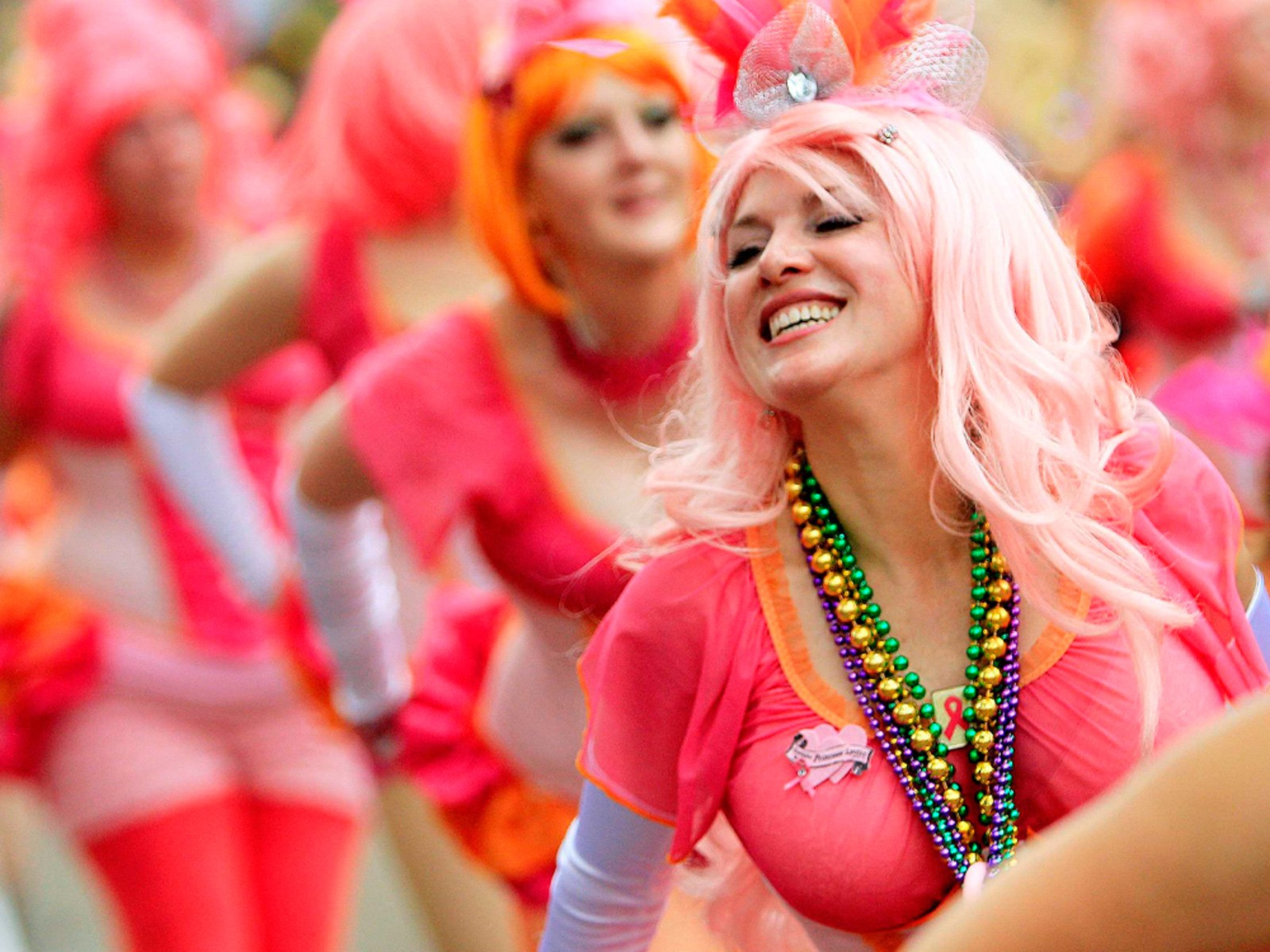 Image: Members of the Pussyfooters Marching Club parade along with the Krewe of Toath along St. Charles Avenue during the weekend before Mardi Gras in New Orleans