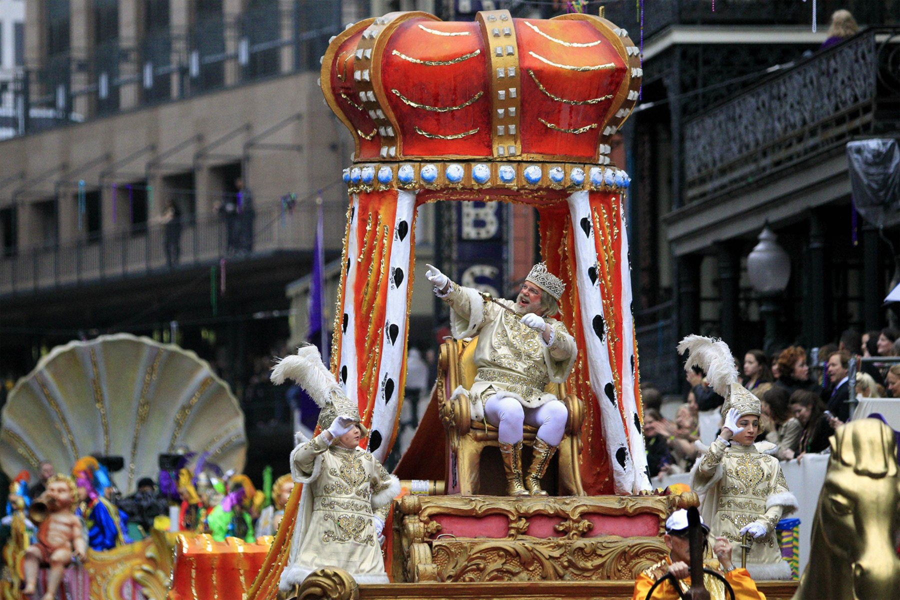 Image: Rex, King of Carnival waves to his subjects as he parades down St. Charles Avenue on Mardi Gras Day in New Orleans