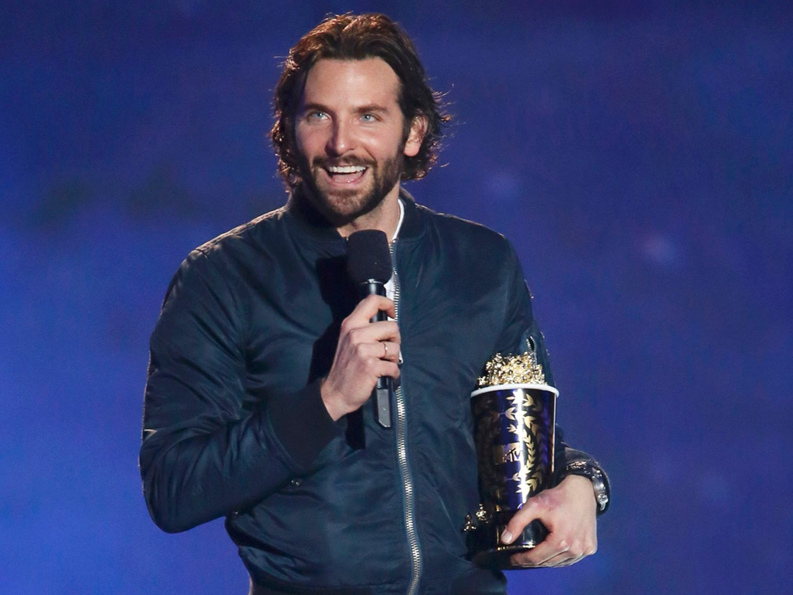 "Image: Actor Bradley Cooper accepts the award for best male performance for ""Silver Linings Playbook"" at the 2013 MTV Movie Awards in Culver City"