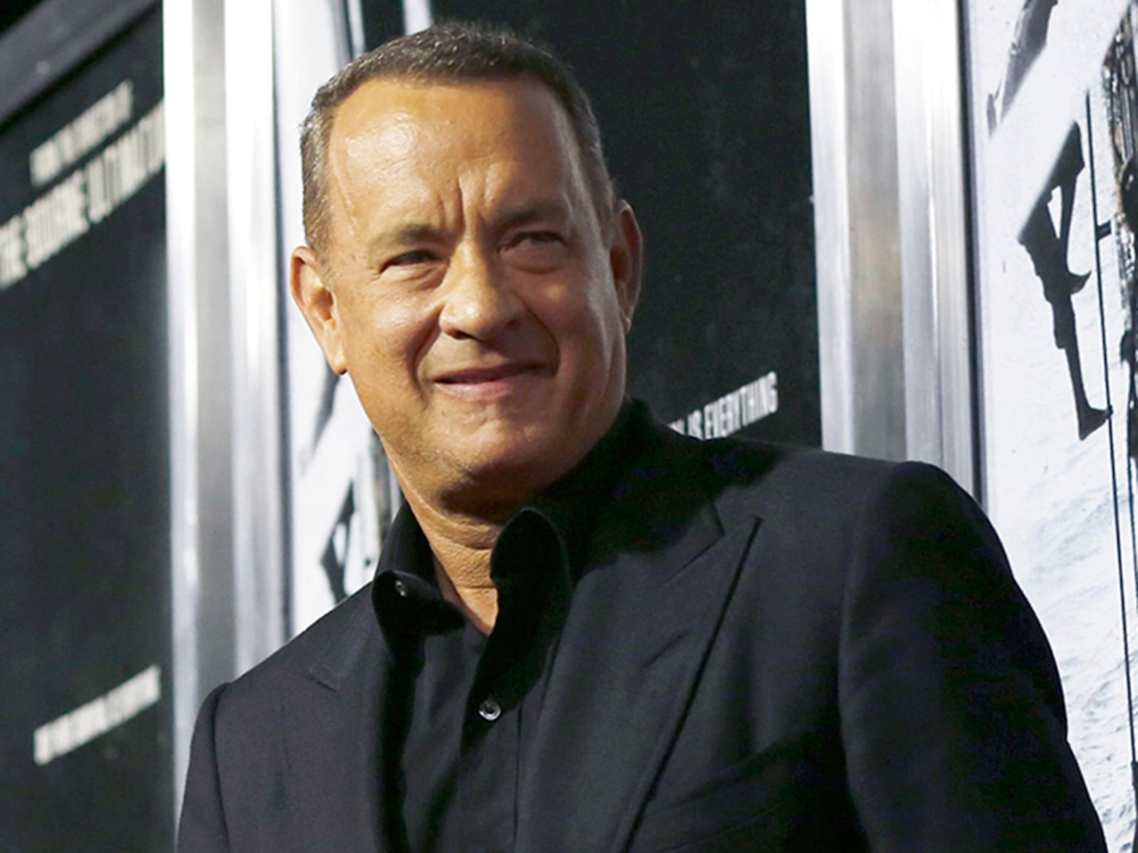 "Image: Tom Hanks poses at the premiere of ""Captain Phillips"" at the Academy of Motion Picture Arts and Sciences in Beverly Hills"