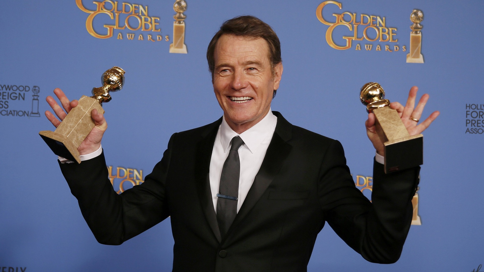 "Image: Actor Bryan Cranston poses backstage after he won the award Best Actor in a TV Series, Drama and for Best TV Series, Drama for ""Breaking Bad"" at the 71st annual Golden Globe Awards in Beverly Hills"