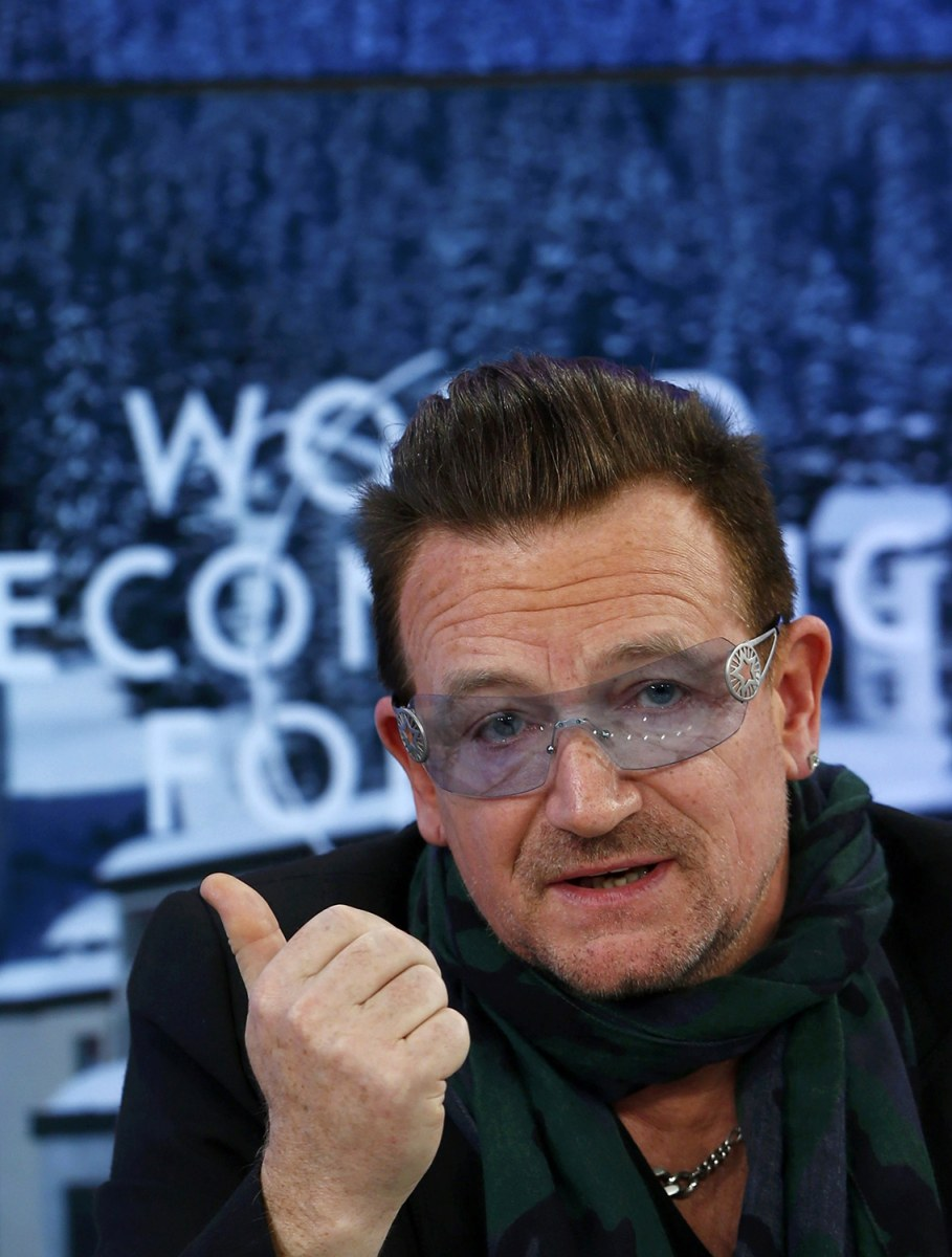 Image: Singer Bono attends a session of World Economic Forum in Davos