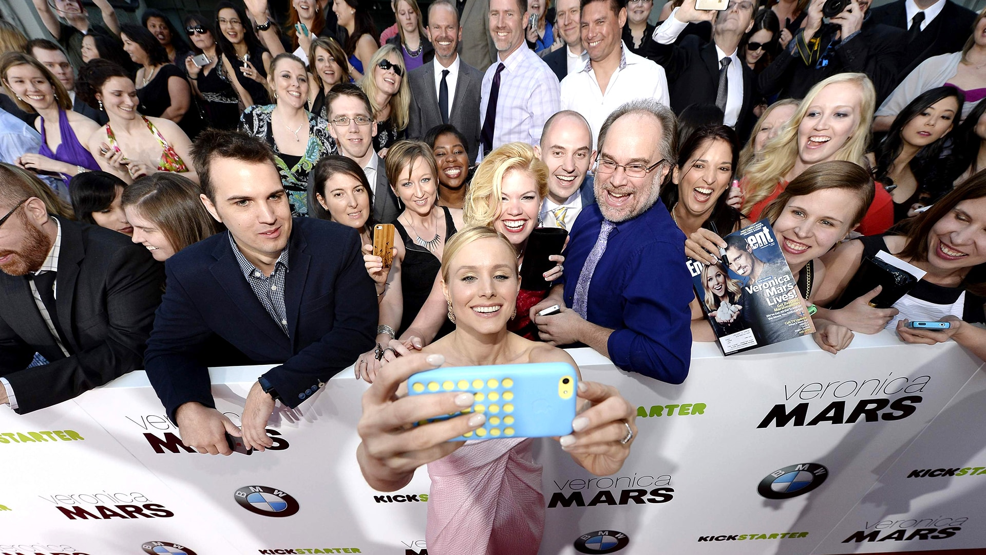 """Image: Cast member Kristen Bell takes a """"selfie"""" with the Kickstarter crowd that helped fund """"Veronica Mars"""" at the premiere of the film at the TCL Chinese Theater in Hollywood"""