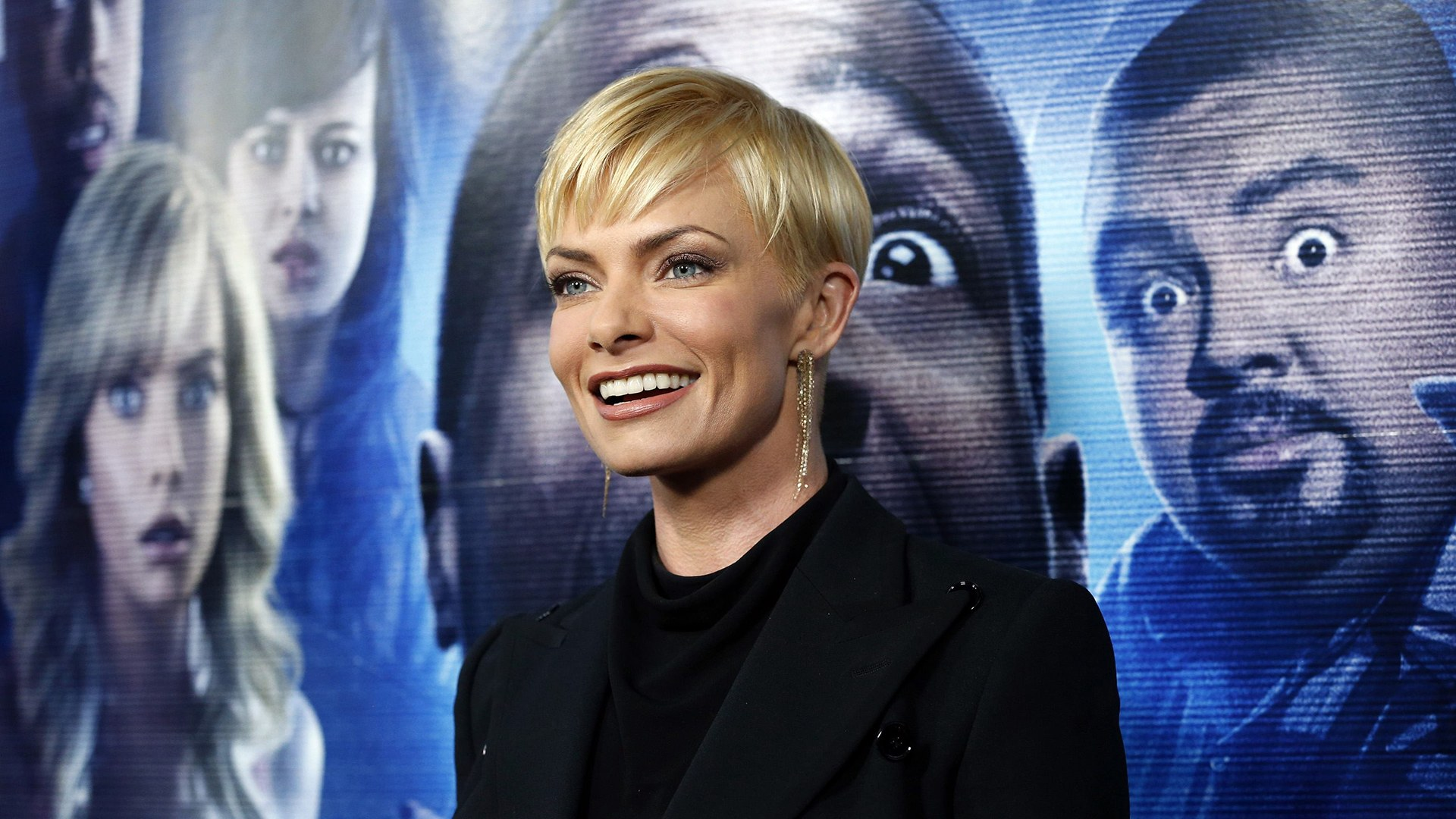 """Image: Cast member Pressly poses at the premiere of """"A Haunted House 2"""" in Los Angeles"""