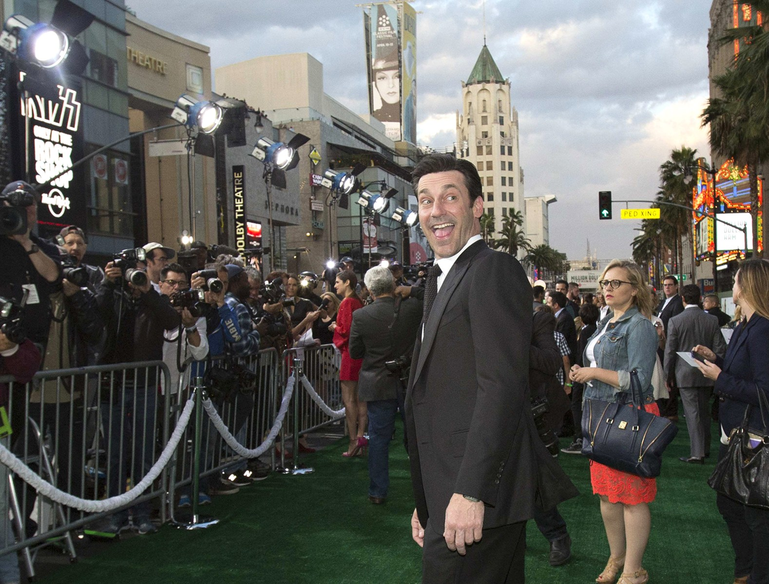 "Image: Cast member Hamm poses at the premiere of ""Million Dollar Arm"" at El Capitan theatre in Hollywood"