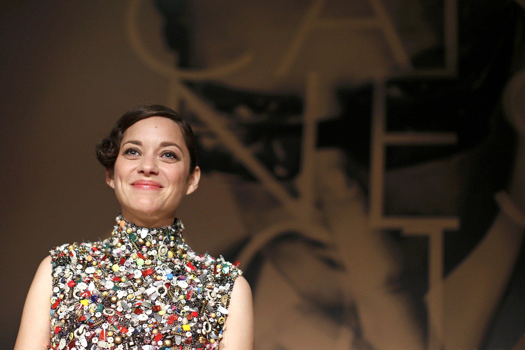"""Image: Cast member Marion Cotillard is seen at the end of a news conference for the film """"Deux jours, une nuit"""" in competition at the 67th Cannes Film Festival in Cannes"""