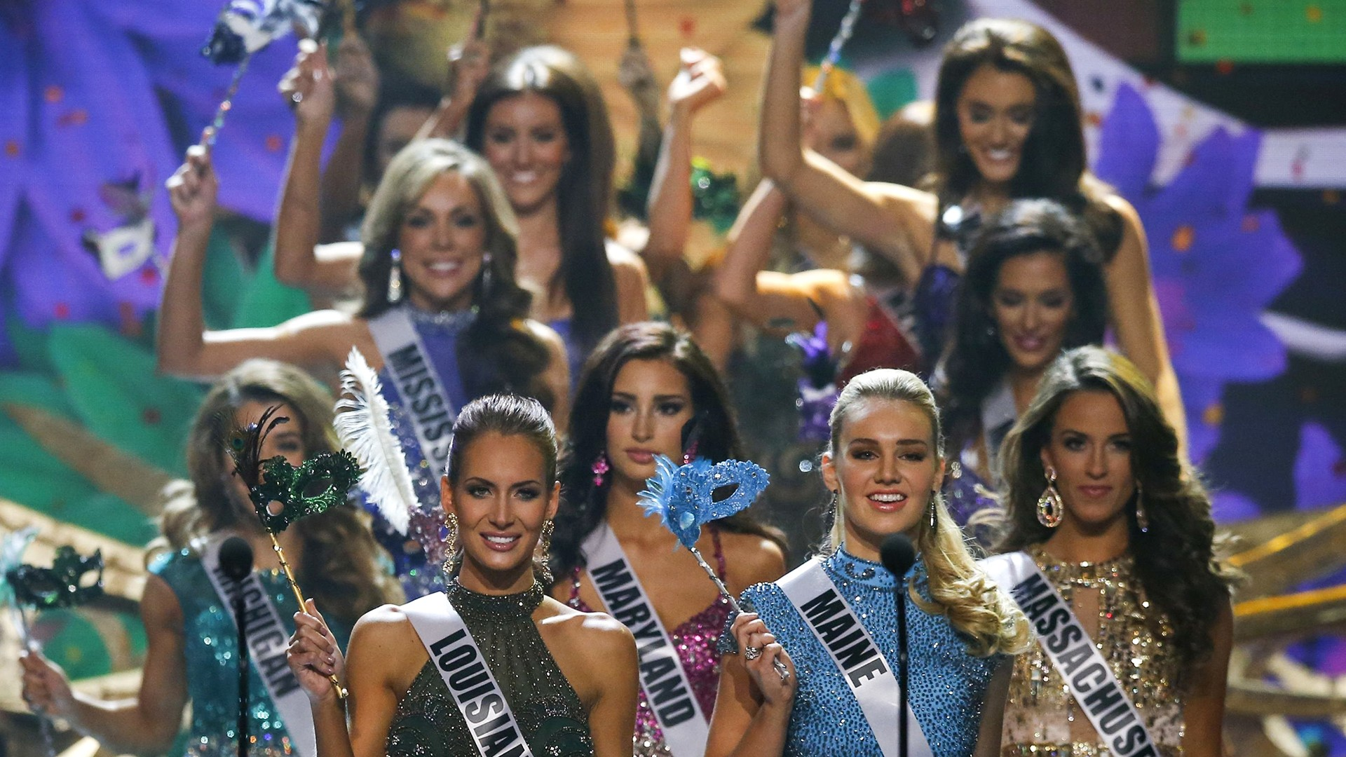 Image: Miss USA contestants take the stage during the 2014 Miss USA beauty pageant in Baton Rouge, Louisiana