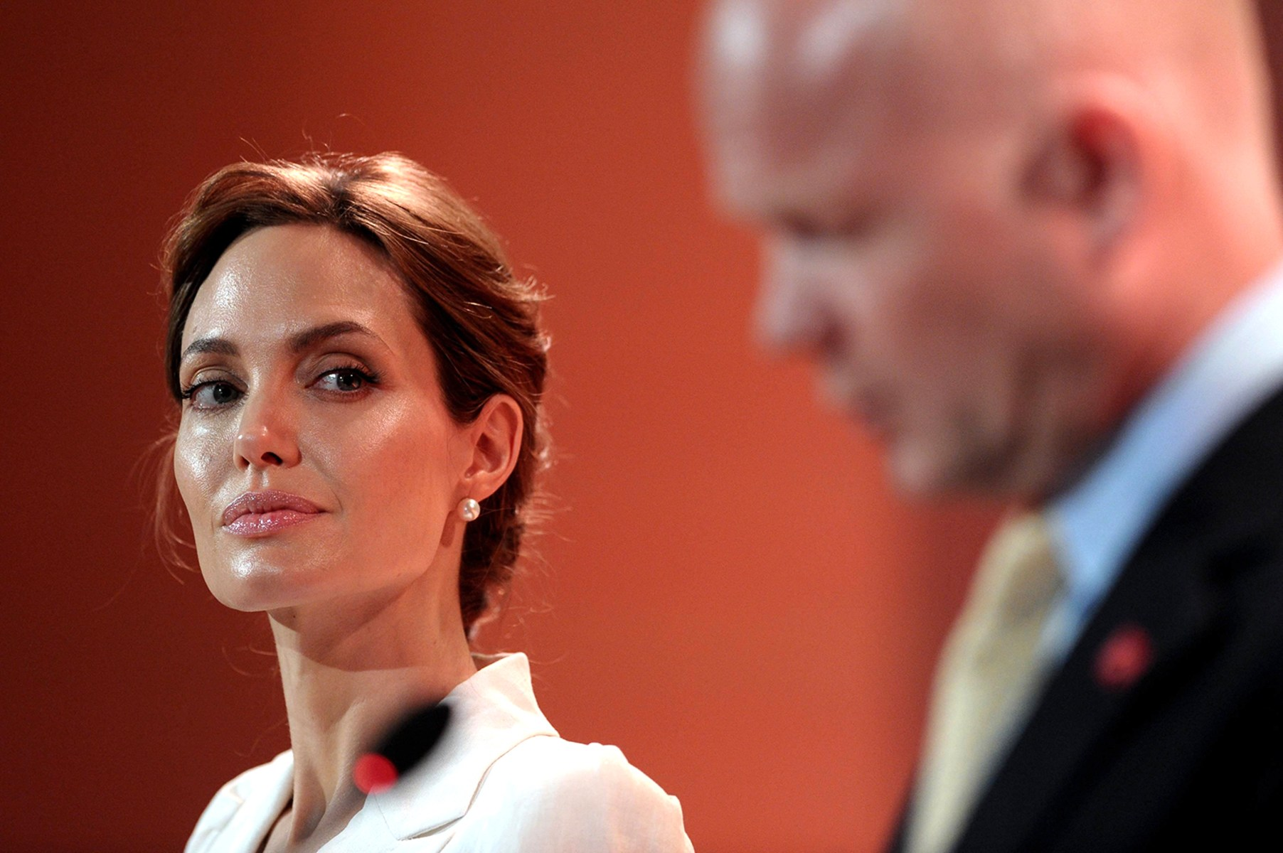 Image: Actress Angelina Jolie and British Foreign Secretary William Hague make their opening speeches at a global summit to end sexual violence in conflict, in London