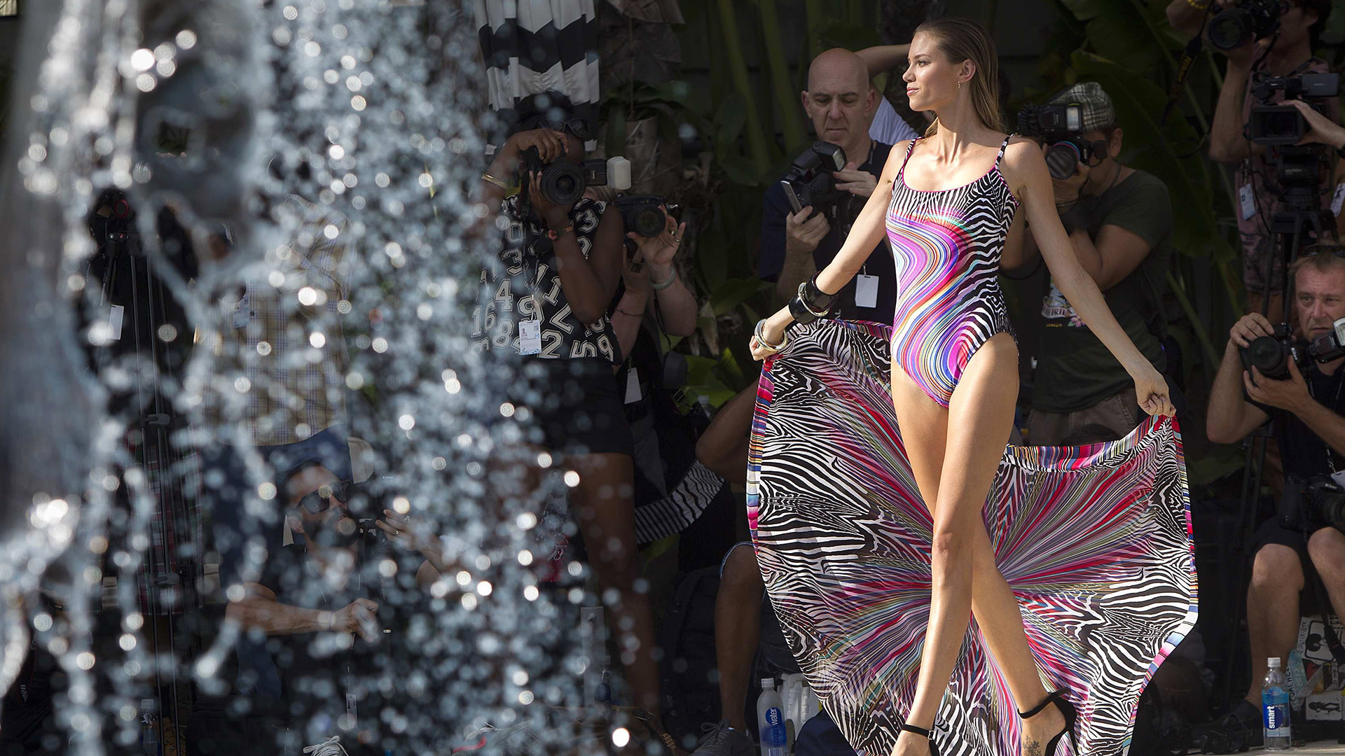 Image: A model presents a creation of the Gottex collection during Mercedes Benz Swim Fashion Week in Miami