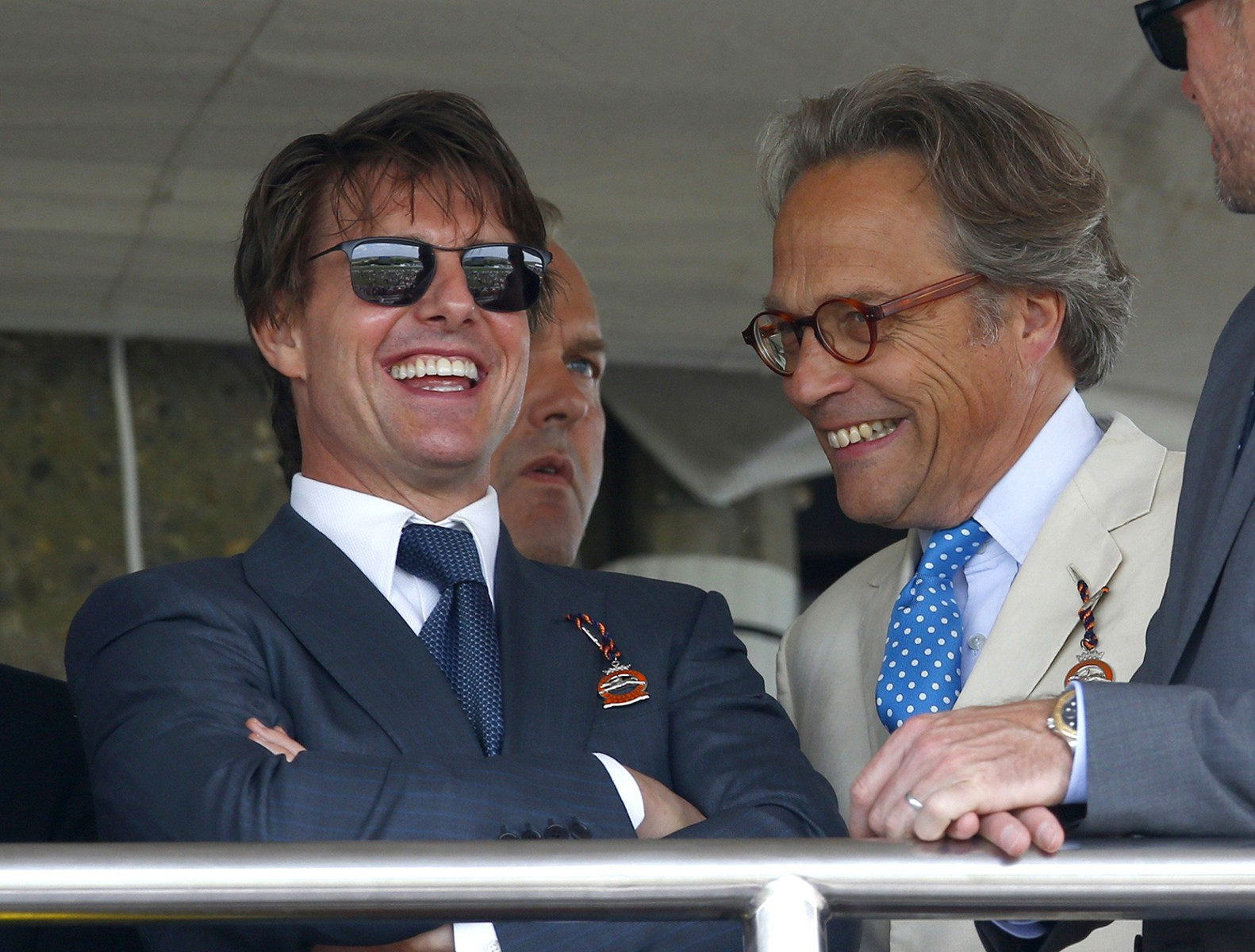 Image: Hollywood actor Cruise talks to Gordon-Lenox, Earl of March, at Goodwood racecourse