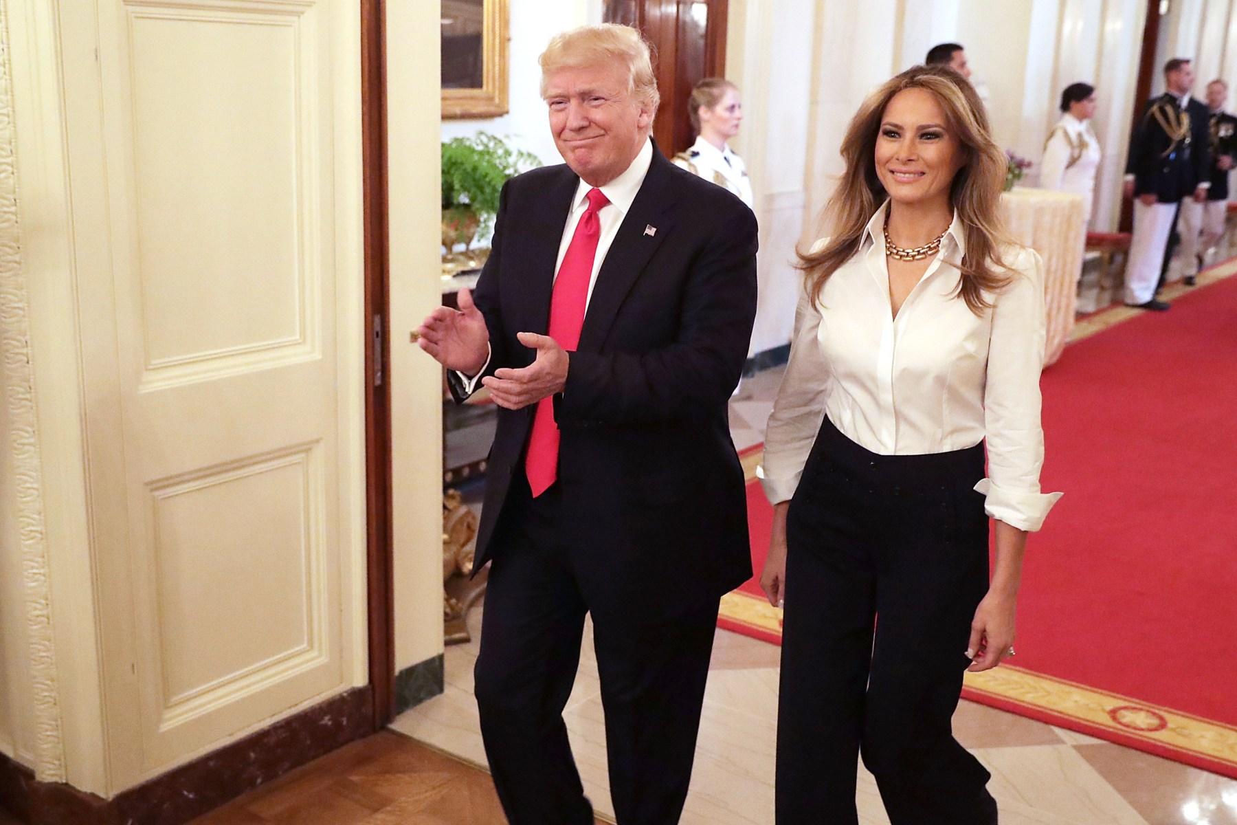 Melania Trump's fashion-forward international travel style ...