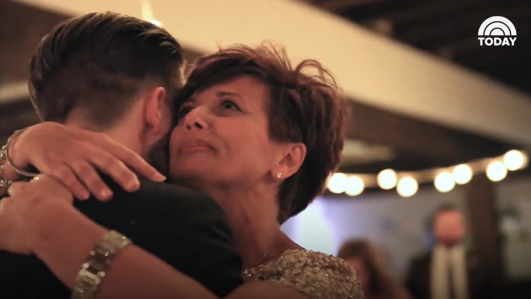 Mother With Ms Lifted Out Of Wheelchair For Wedding Dance Son