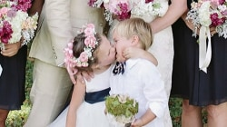 Flower girl steals a kiss (and the spotlight) in viral photo