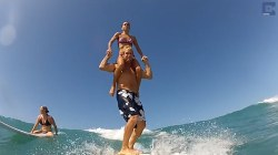 Watch: Couple stuns with gymnastics moves while tandem surfing
