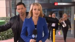 Hugh Jackman photobombs TV reporter
