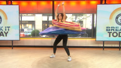 Watch woman attempt world record for hula-hoops spun simultaneously