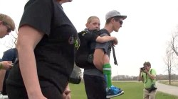 Watch this teen carry brother with cerebral palsy on 111-mile walk