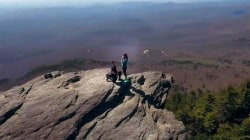 Watch a boyfriend propose on top of a mountain — as captured by a drone