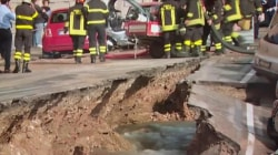 Watch sinkhole swallow cars along river in Italy