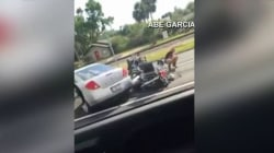 Car drives over motorcycle in road rage incident