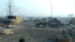 Burned Cars, Razed Homes Litter Town in Wildfire's Wake