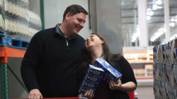 Couple takes engagement photos at a Costco