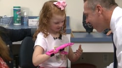 5-year-old gets pink, 3-D printed prosthetic hand — and hope for riding a bike